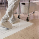Employee walking on cleanroom mat